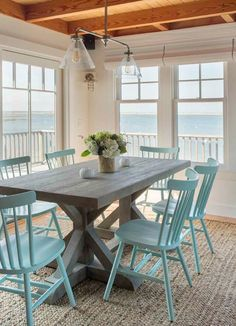 magnificent Martha'S Vineyard Dining Room Beach design ideas with blue dining chairs jute rug ocean view trestle Turquoise Dining Chairs Decor, Marthas Vineyard Interior Design, Beach House Decor, Home, Blue Dining Chair, Cottage Decor, House, New Homes, Coastal Decor