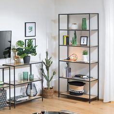 The Ullmer bookcase's warm mango wood shelves seem to float within an iron frame. An x-back supports this edition creating a simplistic, but impactful place to Interior Design Living Room Warm, Diy Interior, Living Room Modern, Living Room Colors, Living Room Decor, Bedroom Decor, Regal Design, Living Room Shelves, Wood Shelves