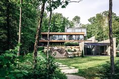 Set in the Laurentian Mountain region of Quebec, the Estrade House uses a natural palette to remain in sync with its lakeside surroundings. Clad in a mixture of stone, timber, and black cedar, the sereis of volumes flow down the...