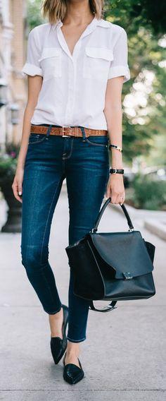 Classic Style   White short sleeve camp shirt, dark wash jeans, brown belt, black point-toe flats, black handbag