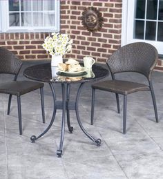 "Granite-top Bistro Set by Wind & Weather. $649.00. Granite-top Bistro Set. Let the sun blast, the rain drench, and the ice coat this bistro set. Crafted with a solid-granite table top, high-density polyethelene-resin wicker chairs, and powdercoat metal construction, it maintains its beauty even when forgotten in the weather between uses. Stackable chairs arrive assembled; minimal assembly for table. Sizes Chairs, 33""H x 22""W Table, 28""H x 30"" Dia. Shipping Ships Motor Fre..."