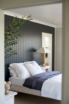 vertical timber panelling on bedroom wall
