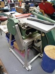 Planer Stand by Mike M. -- Hi, I'm Mike and just a few words about myself. I have a had a workshop of sorts for many years, but up until now I have been working full time and haven't had a great deal of time to spend in it. I am now approaching retirement and am now going down to 3 days a week working to double my time off. Yippee! I yearn for a tidy organinsed workshop, but always seem to have to prioritise geting things done over clearing and organising. My wife no longer works and thus...