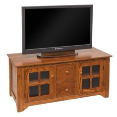 "Amish 50"" Flush Mission TV Stand with Drawers Solid wood quality and beauty for your living room. Includes an adjustable shelf. Shown here in oak wood. Available in 8 wood types so you can customize to match your living room. #TVstands #livingroom"