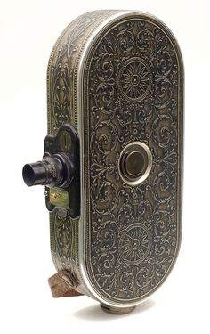 This is the Bell & Howell Filmo 75, a 16mm movie camera made in 1928. It was intended for amateur use but Bell & Howell cameras were...