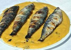 Papas de milho com sardinhas (Corn porridge with sardines)    Traditional portuguese dish that best combines the creamy texture of corn flour with the wonderful flavour of our sardines.    Photo source: on.fb.me/1oNmhvU