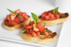 Bruschetta  Ingredients:  6 or 7 ripe plum tomatoes (about 1 1/2 lbs), 2 cloves garlic, minced, 1 Tbsp extra virgin olive oil, 1 teaspoon balsamic vinegar, 6-8 fresh basil leaves, chopped. Salt and freshly ground black pepper to taste, 1 baguette French bread or similar Italian bread, 1/4 cup olive oil. at http://50cheaprecipes.com/?usr=badsc9