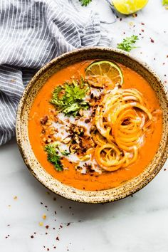 This creamy Zanzibar carrot-tomato soup is an African Inspired type of dairy free bisque. Made with simple wholesome ingredients such as peeled Tomatoes, Carrots, spices, herbs, coconut milk, and a curry or chili paste. It's quick to make and naturally paleo and vegan. A soup for any season!
