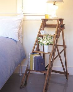 ladder nightstand... could even paint the ladder to style it up a bit.