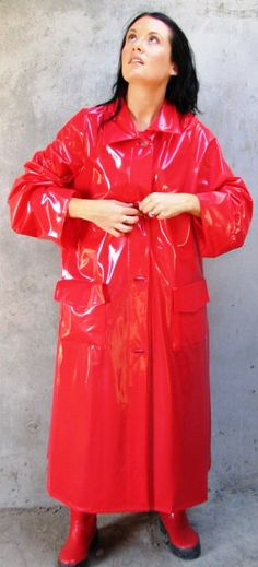 Ready for a walk in her red pvc mac and wellingtons