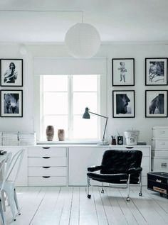black and white family photos in monochromatic home