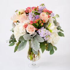 Vase arrangement  of spring pastel flowers