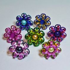 "Love this picture of a ""bouquet"" of my chainmaille flower rings."