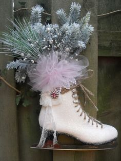 An ice skate is turned into a beautiful winter door wreath