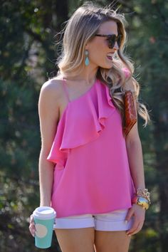 $34.00 One Shoulder Top, Pink Pink is everywhere this season! Jump on the trend with this glam one shoulder top! A ruffled flap gives this top fun movement and plenty of chic appeal. A thin spaghetti strap holds it in place.