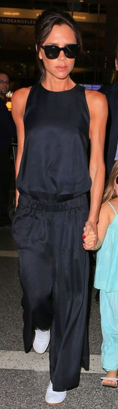Victoria Beckham's blue jumpsuit and black sunglasses