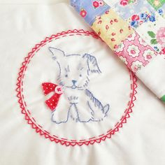 Puppy Embroidery Pillow. I really like that border around Puppy - pretty.