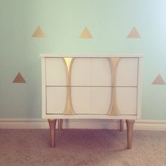 Mid century side table painted in Annie Sloan Chalkpaint pure white with gold accents. Small table with a large impact.