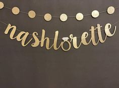 This banner is put together with twine. I have several color options available refer to the 2nd. photo. The ring and circle garland defaults to gold unless you say otherwise. The letters are approx 5-8 inches high. This banner is sure to add glitz to your party. If you dont see something