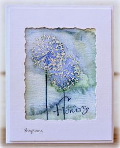 handmade card from Rapport från ett skrivbord: Serendipity Stamps ... work of art ... framed with ragged edge window from deco die cut rectangle .. dandilions emboss in white on watercolor papre ... delightful watercolor wash in background ... awesome card!