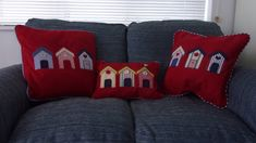A selection of individually appliqued beach hut cushions, finished with piped edges.They are pictured in various colours and sizes. The first red one pictured is rectangular x the other are square 45 x 45 cm.Sold with a hypoallergenic cushion pad Diy Cushion Covers, Cushion Pads, Cushion Ideas, Camper Cushions, Free Motion Embroidery, Textile Art, One Pic, Bed Pillows, Textiles