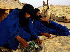 tuareg people   Tuareg Men Preparing for Tea Ceremony Outside a Traditional Homestead ...
