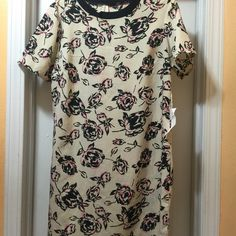 Dress Never worn new with tag has a small rip in the arm pit can  sew it back. Dresses Midi