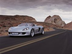 Porsche Carrera GT with Walter Röhrl at the wheel Porsche Carrera Gt, Porsche Design, Press Photo, Car Manufacturers, Cars, Vehicles, Photos, Pictures, Autos
