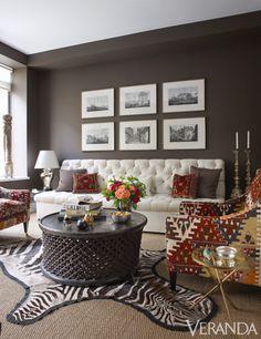 Armchairs in vintage kilims, George Smith. Custom sofa in Cristina Azario hemp. African table, Liza Sherman Antiques.
