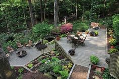 Hilly, wooded backyard with a tiered deck