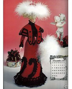 This Winter Walking Suit is the twelveth in The Edwardian Lady Collection series. The dress is a form fitting Red outlined with black. There is