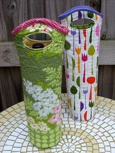 Wine bag pattern and directions. Another great pattern, with strap handles, is available at; http://demandware.edgesuite.net/aamm_prd/on/demandware.static/Sites-JoAnn-Site/Sites-joann-project-catalog/default/v1380888194518/images/hi-res/project/pdf/P488337.pdf