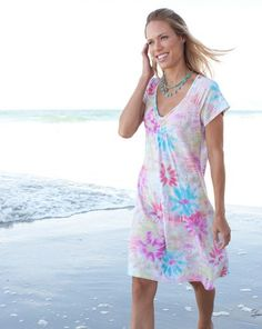 Show your sunny side in our Happyness Effortless Dress with a flattering shape, celebratory print, and pretty details. 92% rayon, 8% lycra,  Happyness print, semi-fitted at bust, flared at hem, gathering at sleeves and back neckline, tucking detail at scoop neckline, above-the-knee length, made in USA