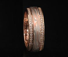 UNIQUE RED GOLD AND DIAMOND WEDDING RING Mokume of 14K palladium white gold, 14K red gold and sterling silver with higher proportion of 14K red gold