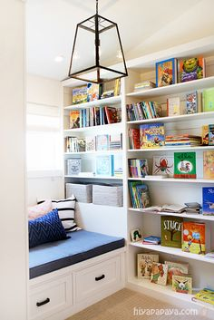 what a fun colorful reading nook for the kids