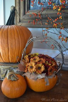 Pumpkin Basket With a Twiggy Handle...stuffed with a fall mum.  Three Pixie Lane.  Instructions included.