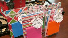sticky note holders {■4×6 plastic standing frame – Walmart – $1   ■Scrapbook paper – on hand   ■Super Sticky Post-it Notes – Walmart – Pkg. of 5 for $2.50!   ■Photo paper –    ■Craft punches (sm. star & 2″ circle/scallop)    ■Jump rings    ■Ribbon    ■Zots glue dots    ■Clear gift bags