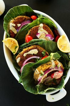 Healthy, Simple BAKED Falafel Burgers! Perfect on greens or pita with a simple hummus-garlic sauce! vegan