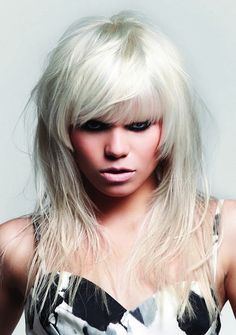 Platinum Blonde Mid-Length Choppy Hairstyle with Swept Bangs