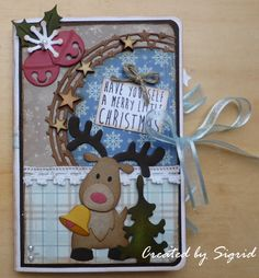Card made by DT member Sigrid with Craftables Stars Semi Circle (CR1293), Creatables Pinetree (LR0136) and Collectables Reindeer (COL1362) and Jingle Bells (COL1363) by Marianne Design