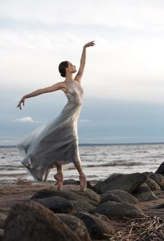 Gorgeous light and dancer by the sea