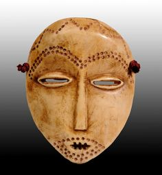 Africa | Lega Bone Mask | Eastern DR Congo. Dots indicate hair.  Simple, effective.