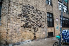Trees Grow from Bricks and a Storefront on the Streets of New York by Pejac
