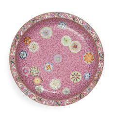 A FINE AND RARE PINK-GROUND FAMILLE-ROSE SGRAFFIATO 'FLOWER-BROCADE' SAUCER DISH<br>SEAL MARK AND PERIOD OF QIANLONG | lot | Sotheby's