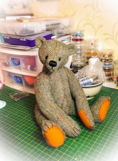 Looks like this adorable bear is made from a mans jacket...I would love to have a bear made out of a memory piece of clothing.