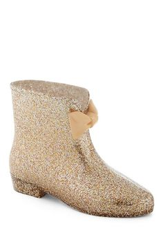 """""""Glitter Patter Rain Boot"""". I'm pretty sure I like these. I always thought traditional rain boots were too tall. And these remind me a LOT of barbie shoes, and for some reason that makes me like them more"""