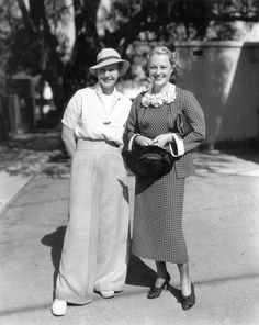 Universal contract stars and fast friends, Binnie Barnes & Sally Eilers, go for a stroll on the lot. Miss Barnes is playing Lillian Russell in 1935's Diamond Brady and Miss Eilers recently completed Alias Mary Dow