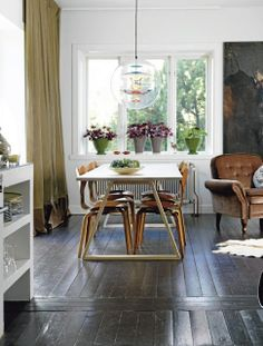 The Verpan VP Globe Suspension Light creates quite a focal point in this dining space http://www.nest.co.uk/browse/brand/verpan/verpan-vp-globe-suspension-light Image via My Scandinavian Home.