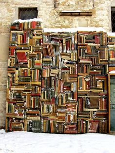 An outdoor bookshelf with no shelves. Photographed in Marche, Italy by Flickr: cepatri55. Via PrettyBooks.tumblr.com