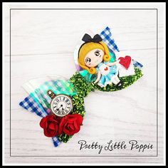 Pretty Alice in wonderland glitter medium bow clay Alice with metal clock charm. Clear pvc fabric and green tinsel glitter for grass, blue/white checked felt backed fabric tails and red rose mulberry paper flowers. on crocodile clip or stretchy nylon white headband approx